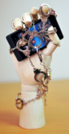 a smartphone, chained with handcuffs